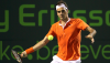 Fish Trips Up Murray, Federer Still Standing
