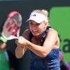 Wozniacki Gains a Quarterfinal Berth at the Miami Open with Muguruza Retirement